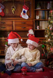 Kids playing under Christmas tree Stock Photo