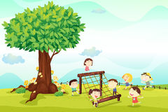 Kids playing under a tree stock photo