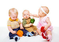 Kids playing with vegetables Royalty Free Stock Photos