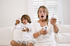 Kids playing video game. Brother and sister playing video game Royalty Free Stock Photography