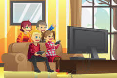 Kids playing video games. A vector illustration of kids playing video games at home Royalty Free Stock Image