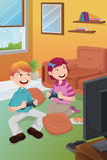 Kids playing video games at home. A vector illustration of kids playing video games at home Royalty Free Stock Image