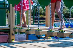Kids playing. View of legs while playing on playground Stock Image