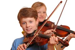 Kids playing violin Stock Photo