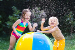 Kids playing with water ball toy Royalty Free Stock Photography