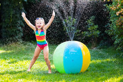 Kids playing with water ball toy Royalty Free Stock Image