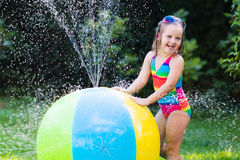 Kids playing with water ball toy Stock Photography