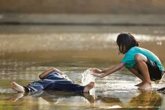 Kids playing in water Stock Images
