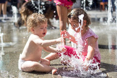 Kids playing in the water Stock Image