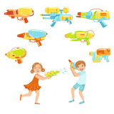Kids Playing With Water Pistols And Assortment Of  Guns Stock Photos