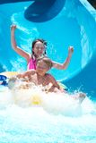 Kids playing on water slide Stock Images