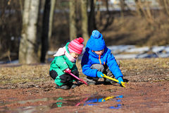 Kids playing with water in spring Stock Photo