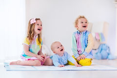 Kids playing in white bedroom Royalty Free Stock Image