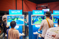 Kids playing WII U console. STRASBOURG, FRANCE - MAY 8, 2015: Kids and adults playing WII U game consoles at the open market Digital Game Manga Show Royalty Free Stock Photos