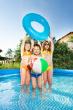 Kids playing with wind ball and swim ring in pool Royalty Free Stock Image