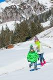Kids playing winter. Royalty Free Stock Photos