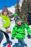Kids playing winter. Stock Photos