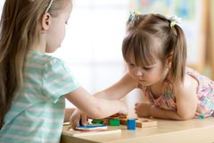 Free Kids Playing With Colorful Block Toys. Two Children Girls At Home Or Daycare Center. Educational Child Toys For Stock Image - 118234121