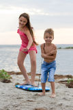 Kids Playing With Surfing Board On Beach Royalty Free Stock Images