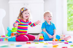 Kids playing with wooden blocks Royalty Free Stock Photos