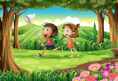 Kids playing at the woods. Illustration of the kids playing at the woods Royalty Free Stock Images