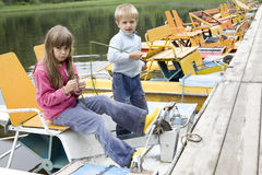 Kids playing in yellow catamaran on river. Little kids playing in yellow catamaran on river Stock Photography