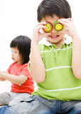 Kids playing with yo-yos. A pair of kids playing with yo-yos Stock Photo