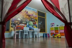Children Room with Toys. Kids playroom with toys and furniture stock photos
