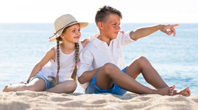 kids pointing with fingers aside Stock Photo