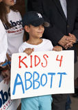 Kids and Politics. Young boy in ball cap holding political campaign sign royalty free stock photography