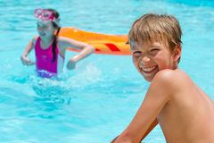 Kids in pool Royalty Free Stock Images