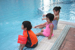 Kids at the pool. Kids having great time at the swimming pool Royalty Free Stock Photo