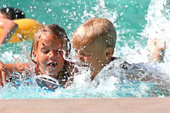 Kids in the pool stock photos