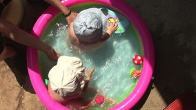 Kids in the pool 02 stock video