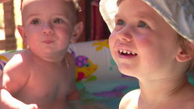 Kids in the pool stock video