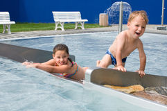 Kids in the pool Stock Photography