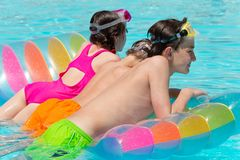 Kids on a pool float Stock Image