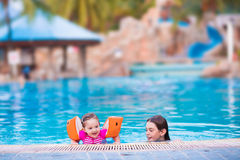 Kids in a pool Royalty Free Stock Image