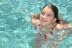Kids and Pools. Beautiful girl in the swimming pool Royalty Free Stock Images