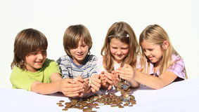 Kids pooring money thru hands. Four happy kids - two girls and two boys pooring money thru hands - savings of czech crowns - small change Royalty Free Stock Image