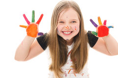 Kids portrait. Cute cheerful girl showing her hands painted in bright colors, isolated over white stock images