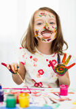 Kids portrait. Cute little girl is painting with gouache stock image