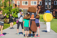 Kids pose with college mascots for mom's photo Royalty Free Stock Images