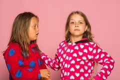 Free Kids Pose On Pink Background. Girls In Colorful Bright Pajamas Royalty Free Stock Photo - 189958905