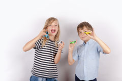 Kids posing with their fidget spinners Royalty Free Stock Image