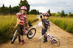 Kids pour out water from shoes Stock Photography