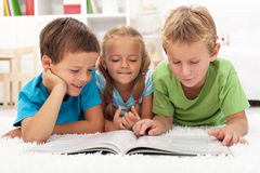 Kids practice reading together Royalty Free Stock Photo