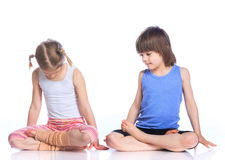 Kids practice yoga royalty free stock photography