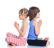 Kids practice yoga Royalty Free Stock Photo