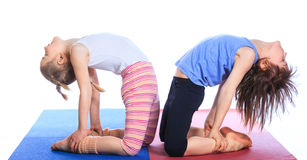Kids practice yoga Stock Photography